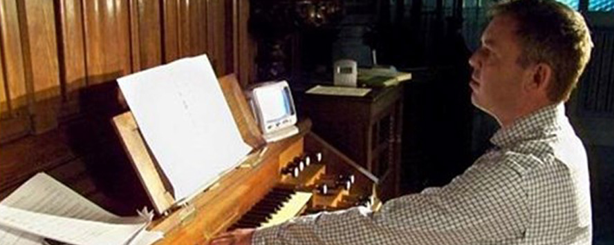 Nick Gale, recording a CD of organ music on the famous Cavaillé-Coll organ of St Michael's Abbey, Farnborough